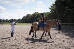 Vorführung von Übungen aus dem Schulreiten an der Longe
